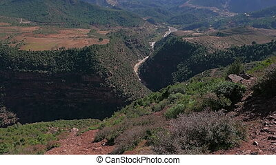 Morrocan Atlas Mountains - Slow tilting shot of overlook on...