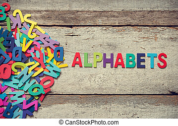 "ALPHABETS - The colorful words ""ALPHABETS"" made with wooden..."
