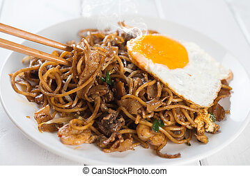 Asian dish Char Kuey Teow - Close-up stir fried char kuey...