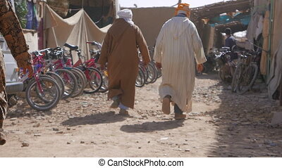 Traditional Moroccan Market - People walking in the...