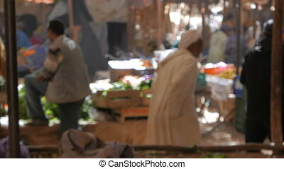 Traditional Moroccan Market - People walking and shopping at...