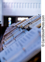 Rows of Hymnals - Hymnals in a catholic chapel of a...