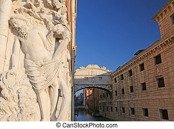 bridge of sighs in Venice in Italy with a statue - Famous...