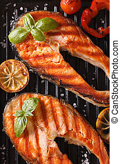Two grilled steak red fish salmon and vegetables on the...