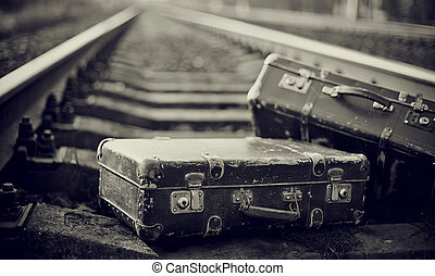 Not the color image of forgotten suitcases on rails. - Not...