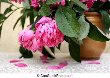 Wilting flowers in vintage clay jar - Wilting big pink...