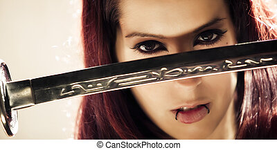 Woman face behind blade - Young beautiful woman face behind...