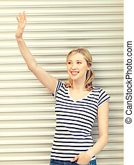happy teenage girl waving a greeting - picture of happy...