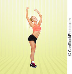 happy beautiful sporty woman dancing