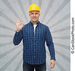 smiling male builder in helmet showing ok sign - repair,...