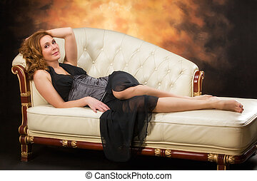 Beautiful adult sexy woman sitting on chair - Beautiful...