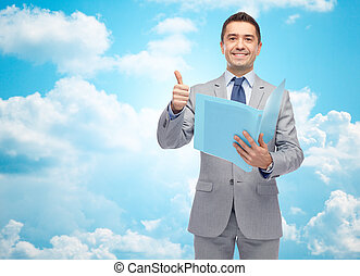 happy businessman with folder showing thumbs up - business,...