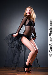 Young slim woman in lingerie