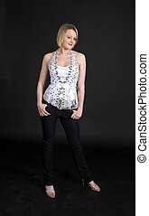 Model in white top against a black background