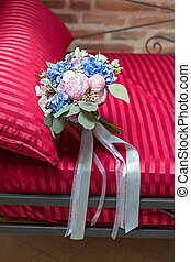 bridal bouquet on a sofa