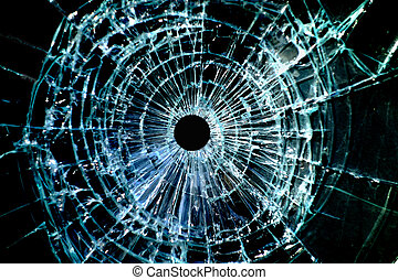 Bullet hole window - Bullet hole in a shattered piece of...