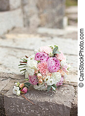bridal bouquet on a stone