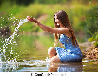 Young woman playing with water.