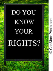 DO YOU KNOW YOUR RIGHTS? message on sidewalk blackboard sign...
