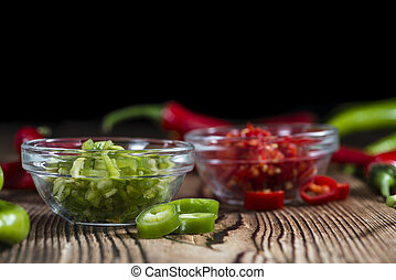 Mixed cutted Chilis red and green on vintage wooden...