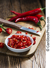 Red Chilis (cutted) on vintage wooden background