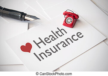 Health insurance - Small telephone on top of business card...