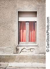 Red curtain behind the window