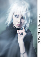 Goth woman surreal portrait. Bright white colors.