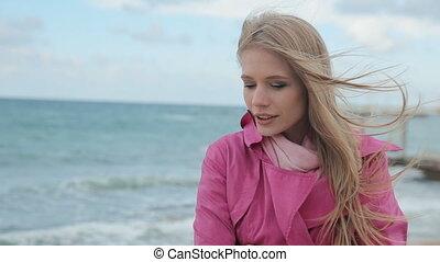 Romantic girl dreaming at sea coast - Optimistic beautiful...