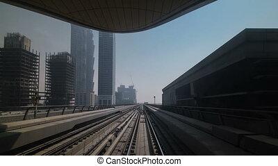 Dubai Metro. A view of the city from the subway car, Dubai, UAE. Timelapse