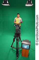 Television presenter on green screen - Television presenter...