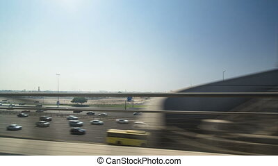 Dubai Metro. A view of the city from the subway car on road,...