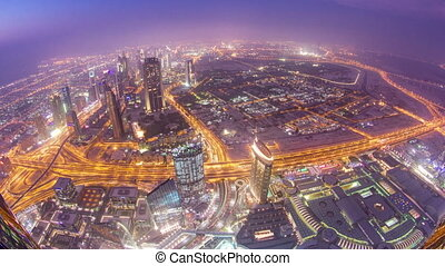 Dubai downtown from day to night transition with city lights from Burj Khalifa timelapse