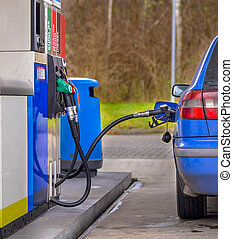 Refuelling blue car - Blue car filling up with fuel at the...