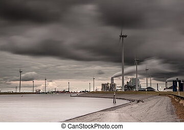 Dark industrial harbor landscape - Long exposure image of...
