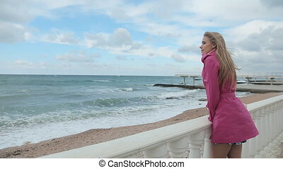 Romantic girl dreaming at sea coast - Optimistic beautiful...