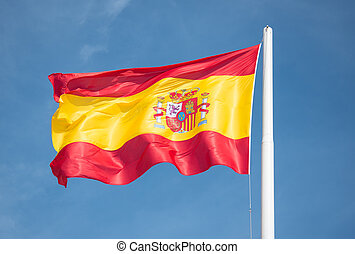 Spanish flag in the wind at high noon