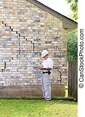 House Foundation Damage - Inspector inspecting home's...