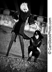 Two goth women. Contrast black and white colors.