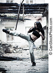 Woman fighter in ruined building. Contrast colors.