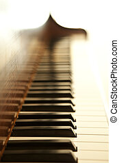 Piano keys - Piano side view with keys lost in the light.