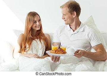 Man serving woman a breakfast
