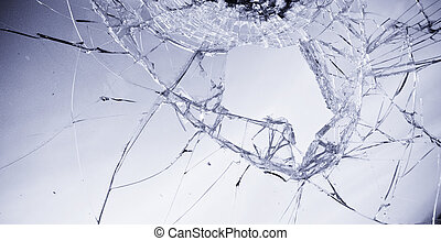 Broken glass in clear blue tone.