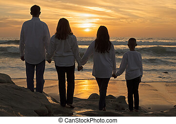 Family unity - Back side silhouettes of father, mother,...