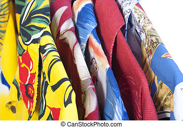 Hawaiian shirts on hangers - Closeup selection of five...