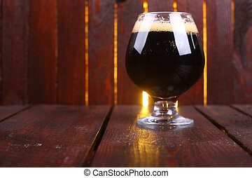 Glass of dark stout - A snifter glass full of dark stout ale...