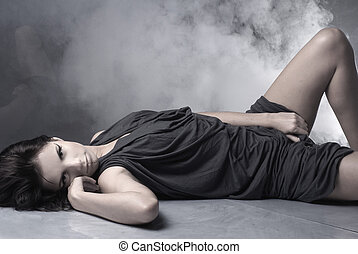 Sexy lady over smoky background