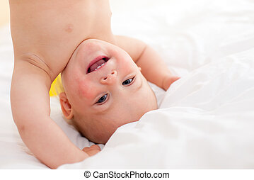 Upside down - Cute little baby girl taking exercise
