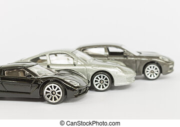Car (small) toys on white background