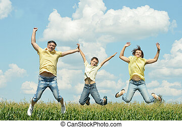 Family jumping outdoors - Happy family jumping outdoors...